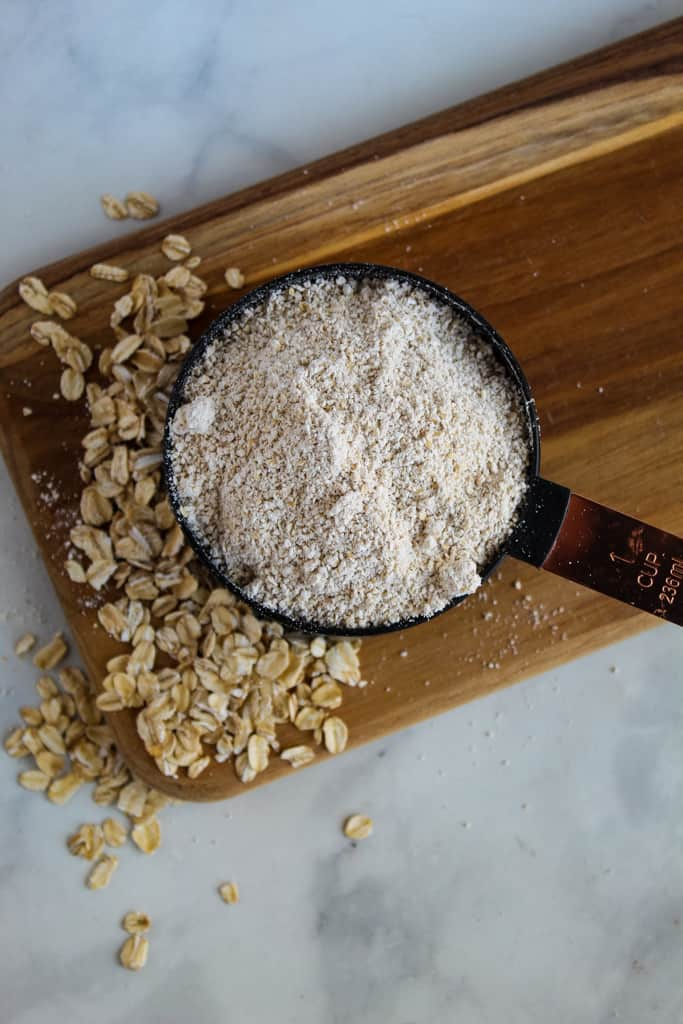 overhead shot of oat flour in a cup