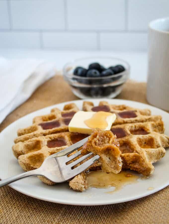 bite on a fork of oat flour waffles