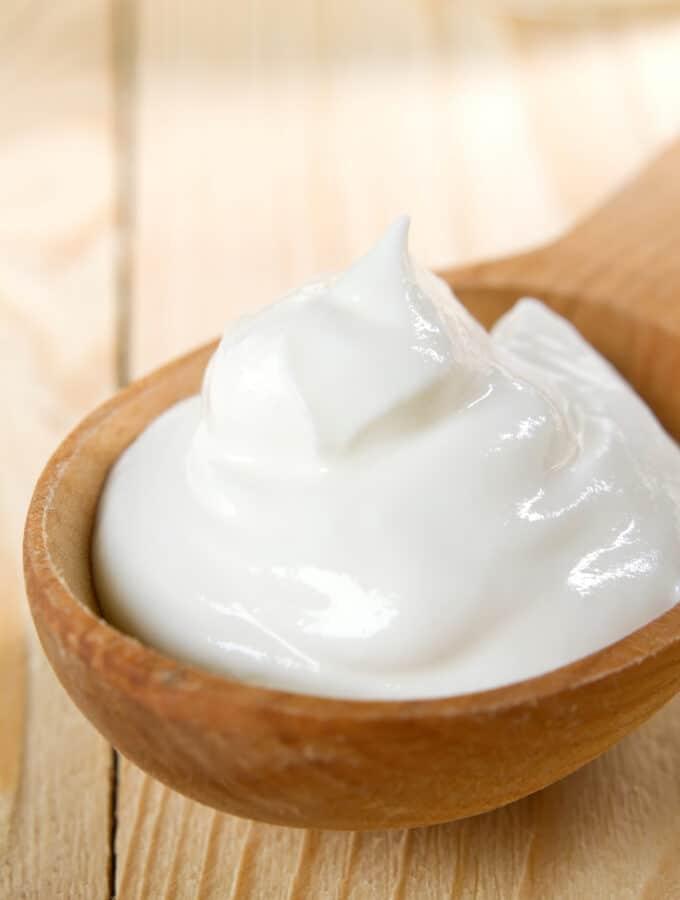 spoon up close of sour cream